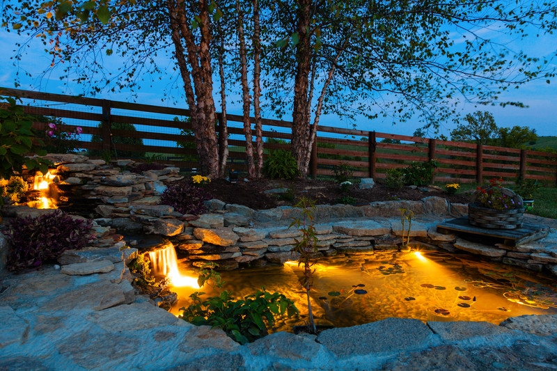 Carefully consider your lighting choices when illuminating ponds and water features to create the desired effect in your backyard.